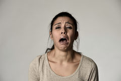 Spanish sad woman serious and concerned crying desperate overacting on feeling depressed. Young beautiful spanish sad woman serious and concerned crying Stock Photos