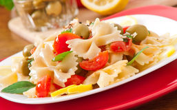 Spanish salad with pasta bows Royalty Free Stock Image