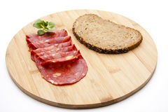 Spanish salamis with bread Royalty Free Stock Photo
