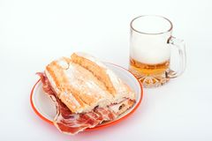 Spanish sandwich and beer. Spanish sandwich of ham and beer ( bocadillo de jamón serrano y cerveza ), if you visit Spain, you must try stock image
