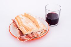 Spanish sandwich of ham with wine. (bocadillo royalty free stock images