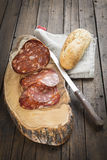 Spanish sausage called morcon on a cutting board Stock Photos