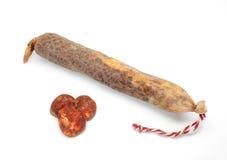 Spanish sausage on white. Lean pork, paprika, salt, garlic ... Stock Photo