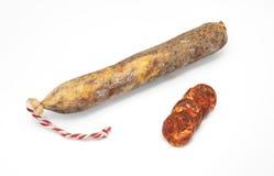 Spanish sausage on white. Lean pork, paprika, salt, garlic... Royalty Free Stock Image
