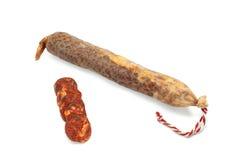 Spanish sausage on white. Lean pork, paprika, salt, garlic ... Royalty Free Stock Photo