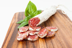 Spanish sausages on wooden textured background Royalty Free Stock Photography