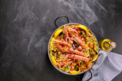 Spanish Seafood Paella Dish on Chalkboard Surface Stock Photos