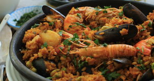 Spanish seafood paella: mussels, king prawns, langoustine, haddock stock video
