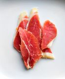 Spanish Serrano cured ham. Four pieces of high quality Spanish serrano-type cured ham against a white background Royalty Free Stock Image