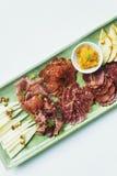 Spanish serrano ham chorizo sausage and cheese tapas platter Royalty Free Stock Photo