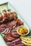Spanish serrano ham chorizo sausage and cheese tapas platter Stock Photos
