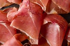 Spanish serrano ham. Closeup of some delicious slices of spanish serrano ham Royalty Free Stock Images