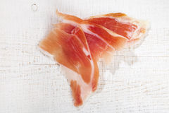 Spanish Serrano Ham Jamon sliced on white Royalty Free Stock Photos