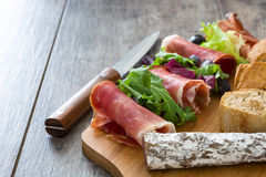 Spanish serrano ham, olives and sausages Royalty Free Stock Images
