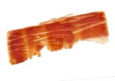 Spanish serrano ham slice isolated on white Stock Image