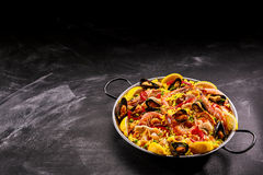 Spanish shellfish and rice next to oil Stock Photography