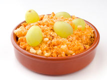 Spanish shepherd crumbs with fresh grapes rural stew Stock Photo