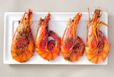 Spanish shrimps with garlic and parsley. Closeup of a plate with spanish shrimps cooked with garlic and parsley Stock Photo