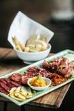 Spanish smoked meats ham and cheese platter starter dish Stock Photo