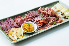Spanish smoked meats ham and cheese platter starter dish Royalty Free Stock Photos
