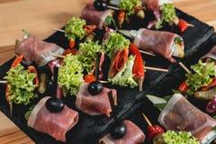 Spanish snack, banderillas on skewers with jamon, ramses, pear, dorblue, chorizo, dried tomato, champignon, pickling Stock Image