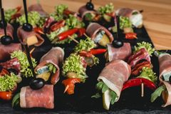 Spanish snack, banderillas on skewers with jamon, ramses, pear, dorblue, chorizo, dried tomato, champignon, pickling Stock Images