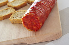 Spanish sobrassada typical of Mallorca, Balearic Islands. Sobrassada, a spreadable sausage typical of Mallorca, Balearic Islands, Spain, on a wooden surface with Stock Photography