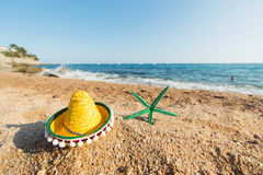 Spanish sombrero at the beach. Sombrero and starfish at the Spanish beach Royalty Free Stock Photography