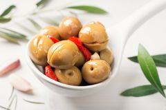 Spanish green olive. Delicious appetizer. Alorena olives. royalty free stock photo