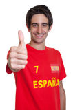 Spanish sports fan with black hair showing thumb up. On an isolated white background for cut out Stock Photography