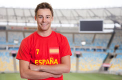 Spanish sports fan at soccer stadium. Lauging spanish sports fan in red jersey of the national team at soccer stadium Royalty Free Stock Photo