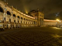 Spanish Square Plaza de Espana in Sevilla at night, Spain. It is a landmark example of the Regionalism Architecture. March, 2018 Stock Photos