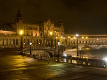 Spanish Square Plaza de Espana in Sevilla at night, Spain. It is a landmark example of the Regionalism Architecture. March, 2018 Royalty Free Stock Images