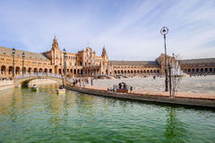 Spanish Square  - Seville. Seville, Spain - January 17, 2015: Tourists and locals on the Spanish Square during Saturday afternoon. The square was completed in Royalty Free Stock Photography
