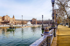 Spanish Square  - Seville. Seville, Spain - January 17, 2015: Tourists and locals on the Spanish Square during Saturday afternoon. The square was completed in Royalty Free Stock Photos