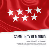 Spanish state Community of Madrid flag. Spanish state Community of Madrid flag waving on an  white background. State name and the text area for your message Royalty Free Stock Photography