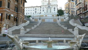 Spanish Steps and fountain in Piazza Spagna at morning time. ROME, ITALY - MAY 31,2017: Spanish Steps and fountain in Piazza Spagna at morning time. 4K footage stock footage