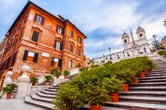 Spanish Steps at Piazza di Spagna and Trinita dei Monti church. The famous Spanish Steps at Piazza di Spagna and Trinita dei Monti church at the top in Rome stock photos