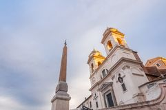 Spanish Steps at Piazza di Spagna and Trinita dei Monti church. The famous Spanish Steps at Piazza di Spagna and Trinita dei Monti church at the top in Rome stock photo
