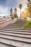 Spanish Steps at Piazza di Spagna and Trinita dei Monti church. The famous Spanish Steps at Piazza di Spagna and Trinita dei Monti church at the top in Rome royalty free stock photos