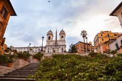 Spanish Steps at Piazza di Spagna and Trinita dei Monti church. The famous Spanish Steps at Piazza di Spagna and Trinita dei Monti church at the top in Rome stock photography