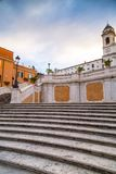Spanish Steps at Piazza di Spagna and Trinita dei Monti church. The famous Spanish Steps at Piazza di Spagna and Trinita dei Monti church at the top in Rome royalty free stock images