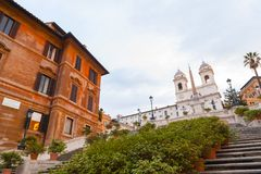 Spanish Steps at Piazza di Spagna and Trinita dei Monti church. The famous Spanish Steps at Piazza di Spagna and Trinita dei Monti church at the top in Rome royalty free stock photography