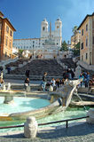 The Spanish Steps, Rome, Italy. The spanish steps, Rome, Italy, seen from the Fontana della Barcaccia, the sinking boat fountain by bernini - At the top of the Stock Photo