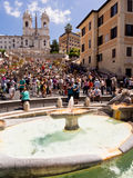 Spanish Steps in Rome, Italy. The Barcaccia Fountain in Piazza di Spagna, looking towards the Spanish Steps and the Trinita dei Monti church. Rome, Italy Stock Image