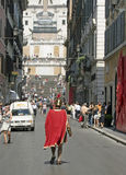 Spanish Steps Rome Italy. Man dressed as  Roman Soldier walks toward  Spanish Steps in Rome, Italy Royalty Free Stock Images