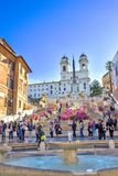 The Spanish Steps in Rome, Italy. People on the the Spanish Steps in Rome, Italy. The monumental stairway of 135 steps are not a place for eating lunch, being Stock Photo