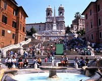 The Spanish Steps, Rome. Tourists sitting on the Spanish Steps with a fountain in the foreground, Rome, Italy, Europe Stock Photo