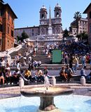 The Spanish Steps, Rome. Tourists sitting on the Spanish Steps with a fountain in the foreground, Rome, Italy, Europe Royalty Free Stock Photography