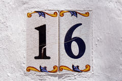 Spanish street number 16. Address spanish street number 16 Royalty Free Stock Photo